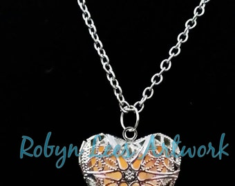 Orange Glow In The Dark Filigree Heart Necklace in Silver on Various Lengths of Crossed Chain