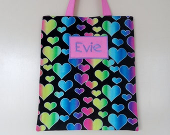 Personalised library/tote bag - variegated pink/green/purple and blue hearts on a black background