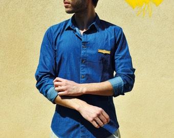 Shirt denim for men. Blue jean. Hand sewn wooden plaque.