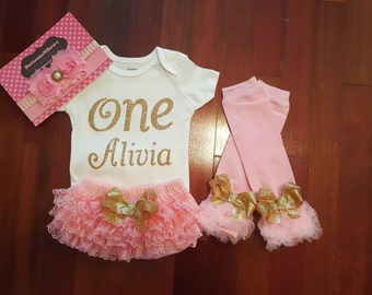 """Gold Glitter Vinyl """"ONE"""" with personalized name bodysuit,Pink Lace Bloomers, Leg Warmers, & Headband Set, baby girl,1st Birthday,Cake Smash"""