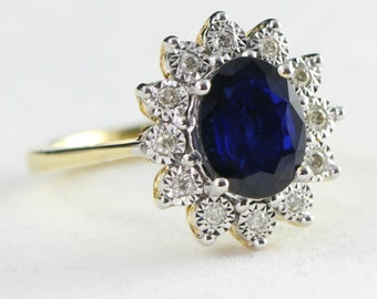 Sapphire and diamond cluster engagement ring in 9 carat gold