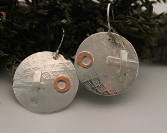 round disk earrings ,x's and o's, textured, silver, copper