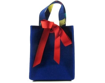 Small sapphire blue wool felt bag with colourful handles and red ribbon - compact, stylish and functional