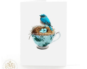 Blue bird in a teacup with a birds nest and eggs, Easter card, birthday card, all occasion card