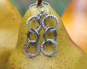 Petite Triple Hoop Silver Earrings: Torch Fused, Hammered and Textured Fine Silver Hoop Earrings.  3 Interlocking Rings. Urban Rustic.