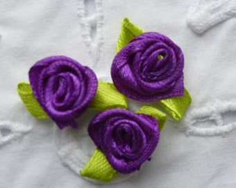 Purple satin roses.   Approximately 16mm wide and 25mm across.  Set of 20