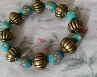 Hand crafted beaded bracelet with assorted blue & gold acrylic beads