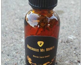 Uncross my money oil spiritual hoodoo conjure oil
