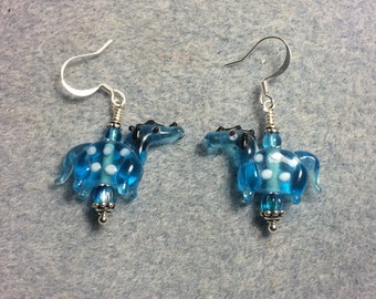 Translucent turquoise with white spots lampwork horse bead earrings adorned with turquoise Czech glass beads.