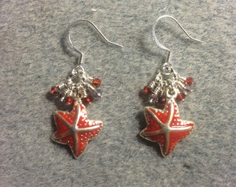 Red enamel starfish charm earrings adorned with tiny red and clear Chinese crystal beads.