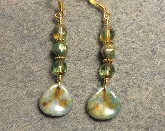 Light green Picasso Czech glass rose petal dangle earrings adorned with light green Czech glass beads.