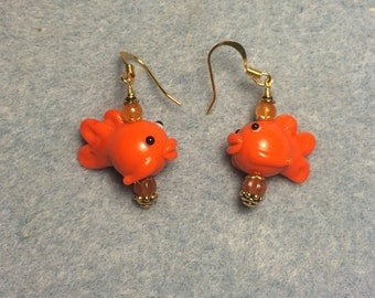 Orange lampwork fish bead dangle earrings adorned with orange Czech glass beads.