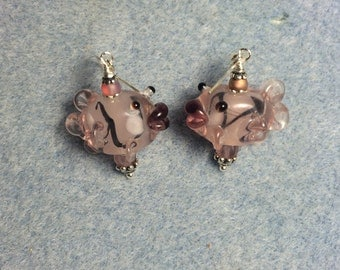 Pink and black lampwork kissing fish bead earrings adorned with pink Czech glass beads.