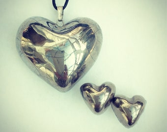 Silver heart pendant and earring set.