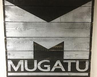 Mugatu Logo Painted on Reclaimed Wood