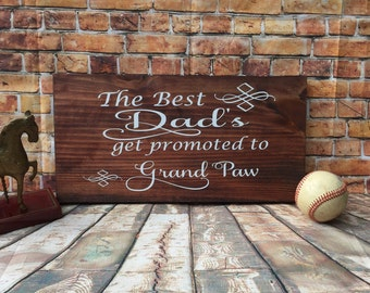 The best dads get promoted to grand paw stained wooden sign