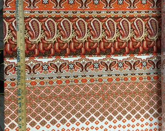 100% Rayon with paisleys in oranges and browns. 58-60 inches wide.