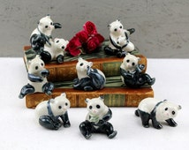 8 panda figurines quality showcases figures handmade from West Germany