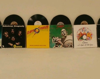 Six dolls house 1:12th records by Queen with removable record