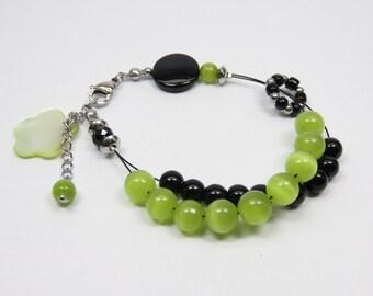 LIQUIDATION - Bracelet ranks, abacus, knitting row counter counter, lime green cat eye, black glass beads, flower charm
