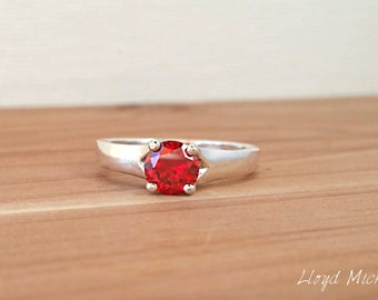 A Brilliant Cut Red Zircon Ring  set in Sterling Silver.
