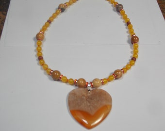 Beaded hand made necklace. W/ yellow jade