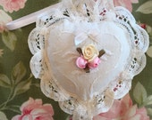 A very feminine pillow sachet with Battenburg lace, and pink and ivory ribbon roses.