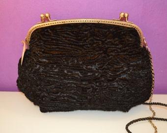 Black velvet bag and nozzle closure