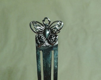 A sterling silver butterfly bookmark