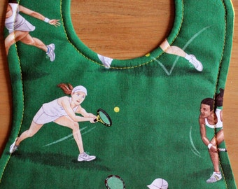 Tennis players on bright green background baby bib