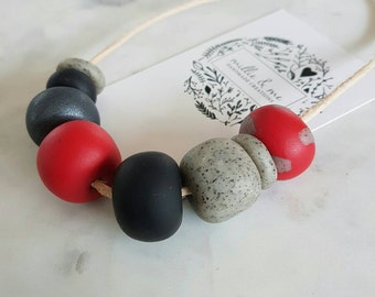 Red, charcoal and granite clay bead necklace.