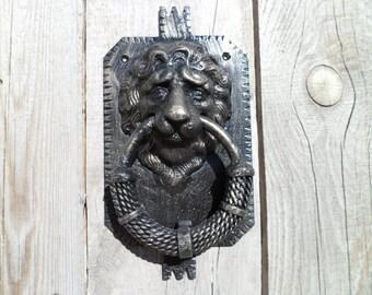 Metal Door Knocker in the form of a lion's head.