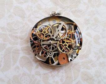 Sterling silver bezel steampunk resin pendant