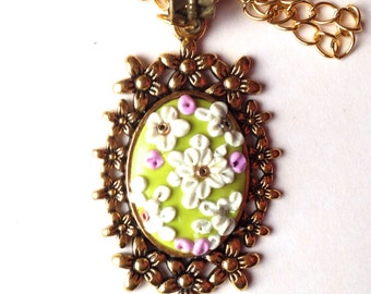 Flower pendant, polymer clay, oval, Golden