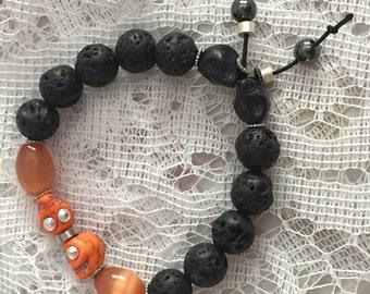Black Lava Rock Bead and Orange Stone Skull Halloween Stretch Bracelet