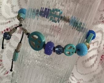 Turquoise Peace Signs and Blue Bead Stretch Bracelet
