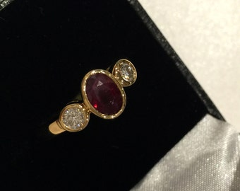 Fine Ruby (1.10ct) and Diamond (0.15 x 2) vintage ring in 18K Yellow Gold