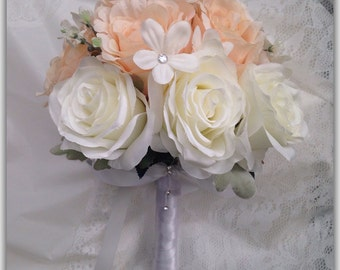 Wedding bouquet for bridesmaids peach and white roses.