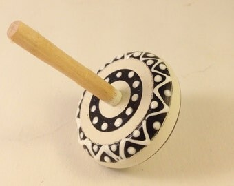 White and Black Stripped Wooden Toy Top