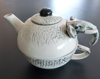 An elephant Teapot and cup for one.