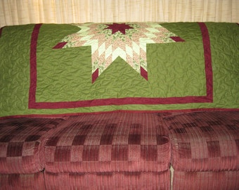 Maroon and green lap star quilt
