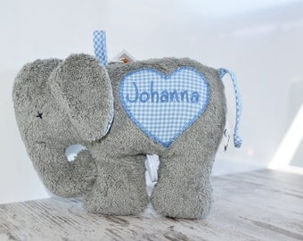 """Cuddly elephant with the name """"reserved"""""""