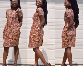 African Ankara knee length dresses with two sides pockets. Ankara print with brown and ivory color.