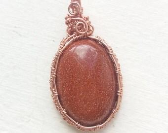 goldstone copper wire cabochon pendant