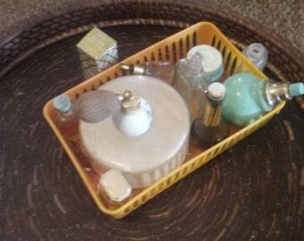 Variety of antique perfumes and powder box