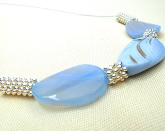 Necklace with 3 chalcedony and asterisk beads (owner)