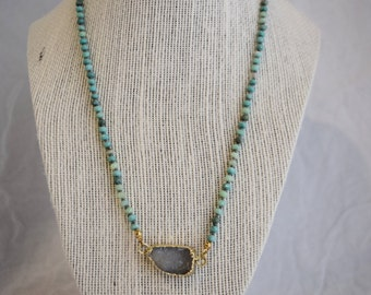 Small geode with mint beads on knotted silk necklace.