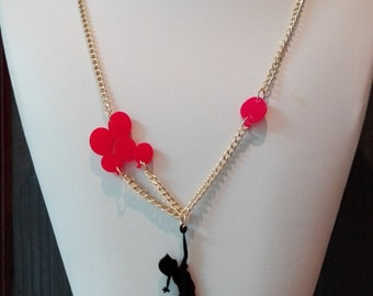 Plexiglas necklace, girl with balloons, laser cutting.    Plexiglas necklace, little girl with balloons, laser cutting.