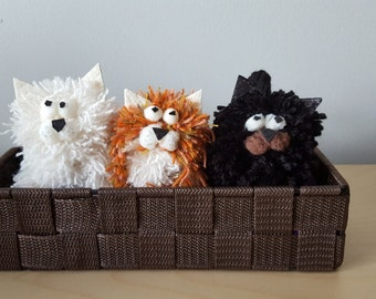 Three cute animals in a basket