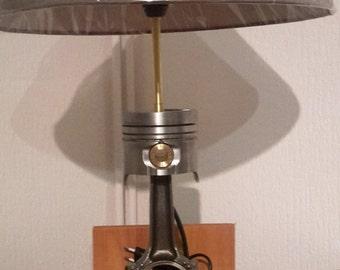 Lamp piston rod